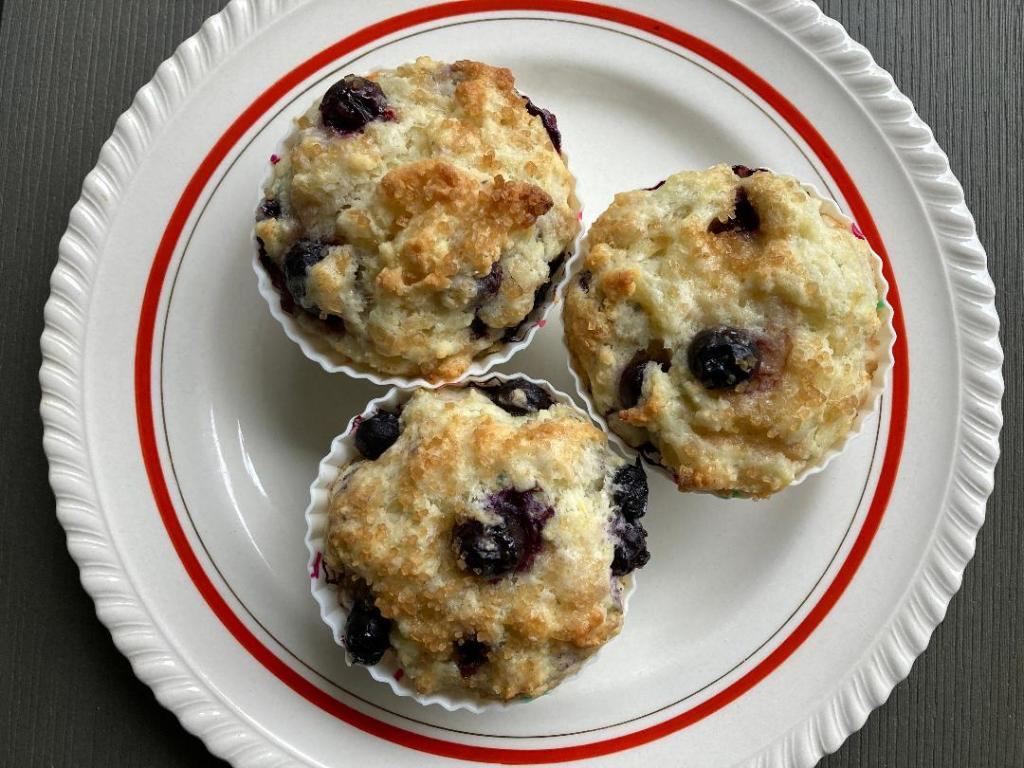 Plate with three blueberry muffins